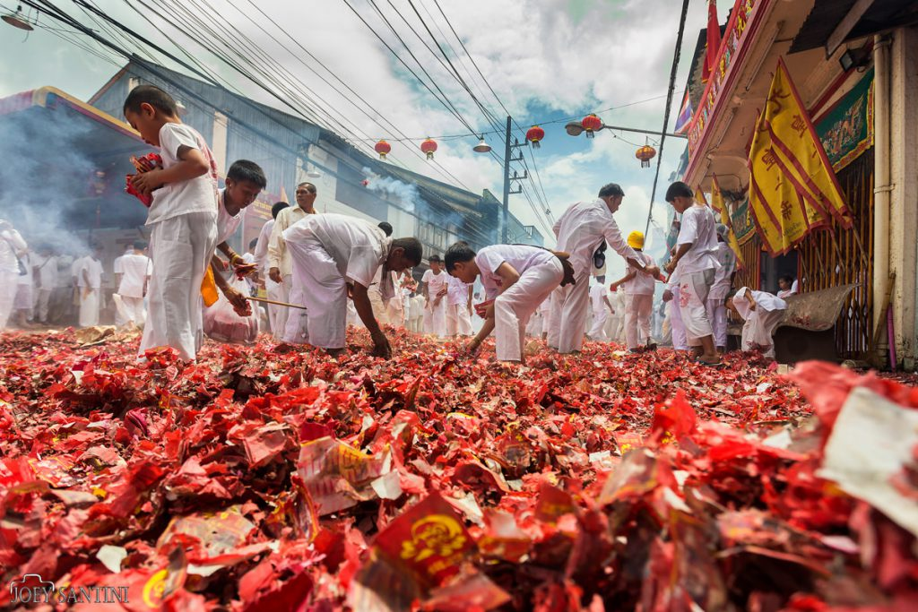 Red carpet of firecrackers on Takua Pa