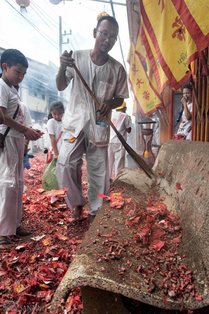Cleaning the red carpet after the procession