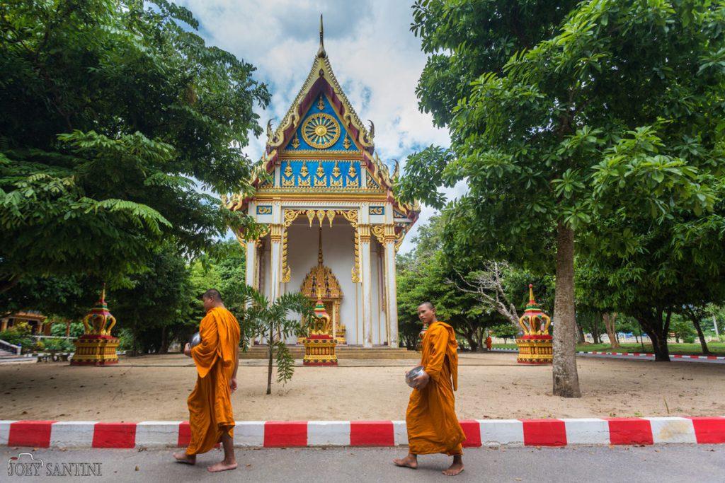 Monks walking outside Buddha Cave
