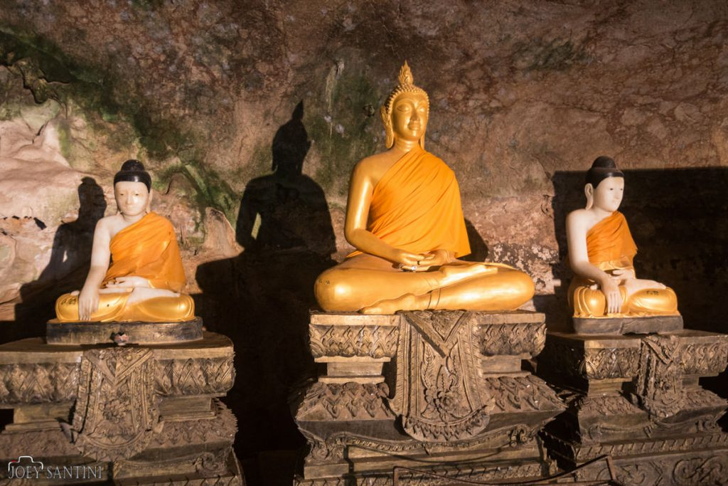 Golden statues inside the Buddha Cave in Phang Nga