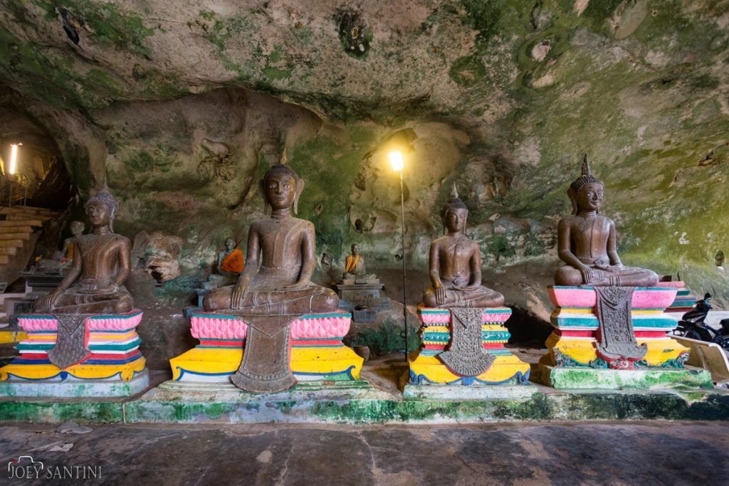 Decorated statues inside the cave in Phang Nga