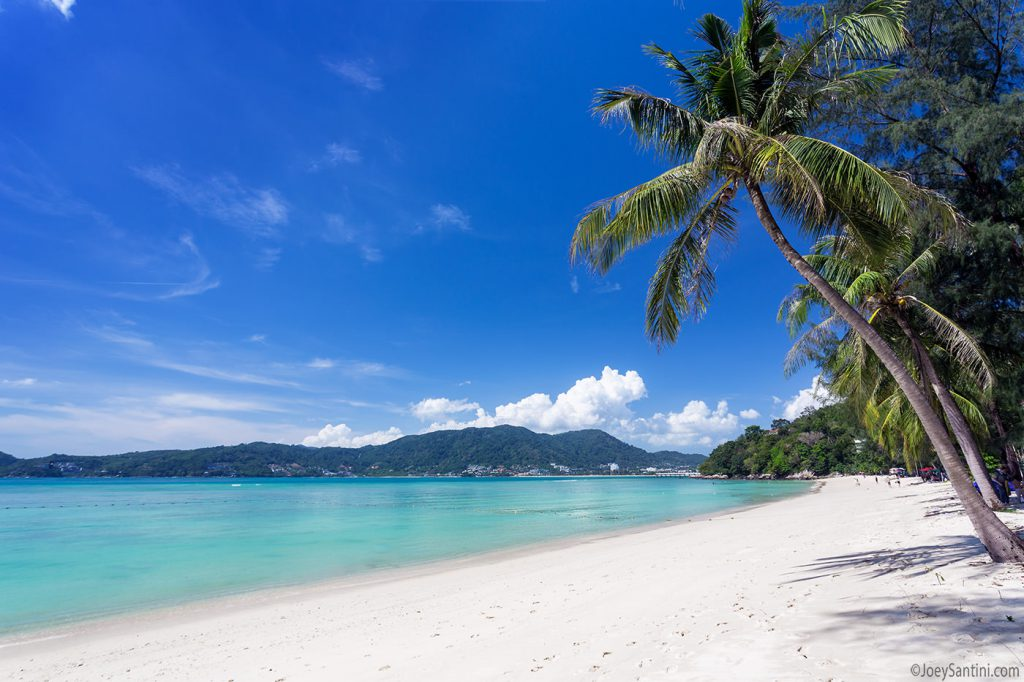 Soft sand, crystal-clear water, coconut palms.